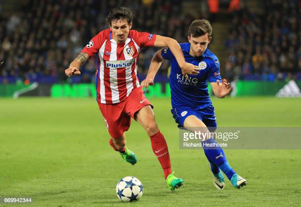 Stefan Savic of Atletico Madrid and Ben Chilwell of Leicester City battle for possession during the UEFA Champions League Quarter Final second leg...