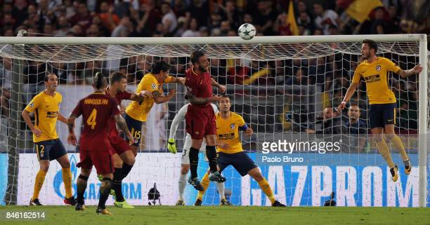 Stefan Savic of Atletico Madrid and Daniele De Rossi of AS Roma in action during the UEFA Champions League group C match between AS Roma and Atletico...