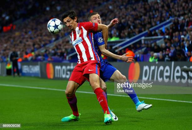 Stefan Savic of Atletico Madrid and Jamie Vardy of Leicester City battle for possession during the UEFA Champions League Quarter Final second leg...