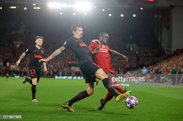 Stefan Savic of Atletico Madrid battles for possession with Sadio Mane of Liverpool during the UEFA Champions League round of 16 second leg match...
