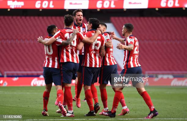 Stefan Savic of Atletico Madrid celebrates a goal with Sauel Niguez, Felipe, Yannick Ferreira Carrasco and Angel Correa which was later disallowed by...
