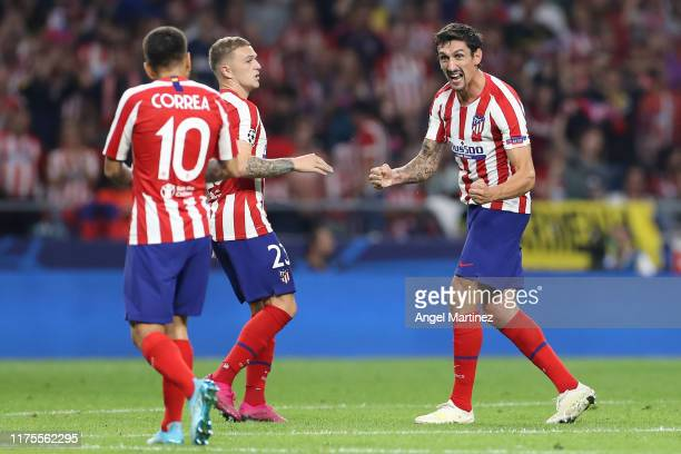 Stefan Savic of Atletico Madrid celebrates after scoring his sides first goal during the UEFA Champions League group D match between Atletico Madrid...