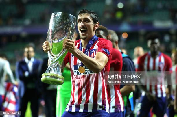 Stefan Savic of Atletico Madrid celebrates with the trophy following the UEFA Super Cup between Real Madrid and Atletico Madrid at Lillekula Stadium...