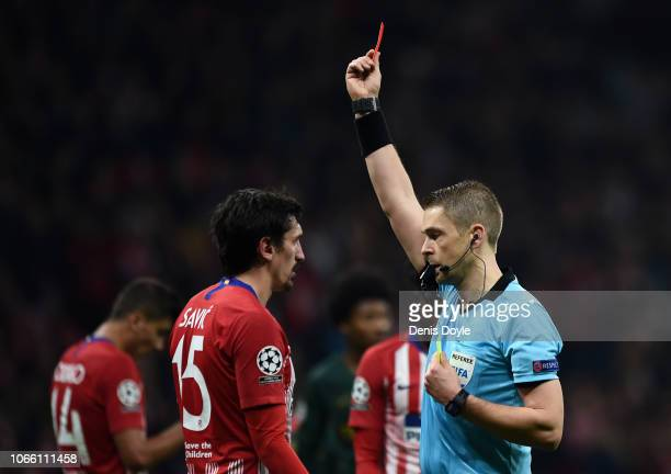 Stefan Savic of Atletico Madrid recieves a red card during the UEFA Champions League Group A match between Club Atletico de Madrid and AS Monaco at...