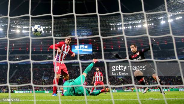 Stefan Savic of Atletico scores an own goal during the UEFA Champions League Round of 16 first leg match between Bayer Leverkusen and Club Atletico...