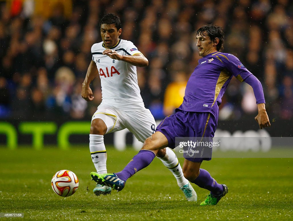 Stefan Savic of Fiorentina clears the ball from Paulinho of Spurs during the UEFA Europa League Round of 32 first leg match between Tottenham Hotspur FC and ACF Fiorentina at White Hart Lane on February 19, 2015 in London, United Kingdom.