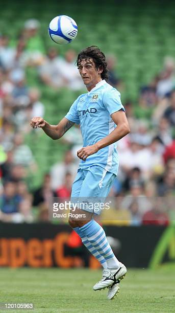 Stefan Savic of Manchester City heads the ball during the Dublin Super Cup match between Manchester City and Airtricity XI at Aviva Stadium on July...