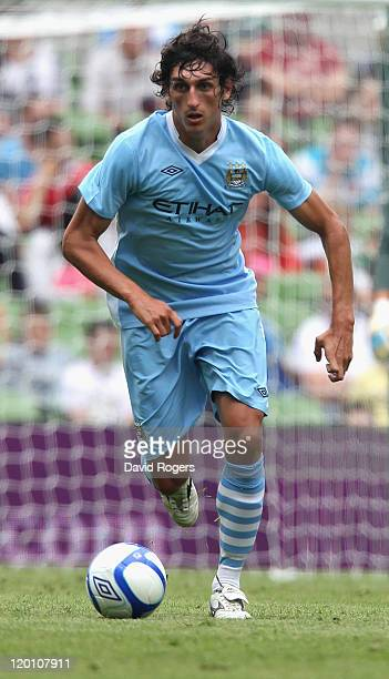 Stefan Savic of Manchester City runs with the ball during the Dublin Super Cup match between Manchester City and Airtricity XI at Aviva Stadium on...