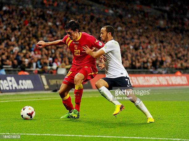 Stefan Savic of Montenegro and Andros Townsend of England battle for the ball during the FIFA 2014 World Cup Qualifying Group H match between England...