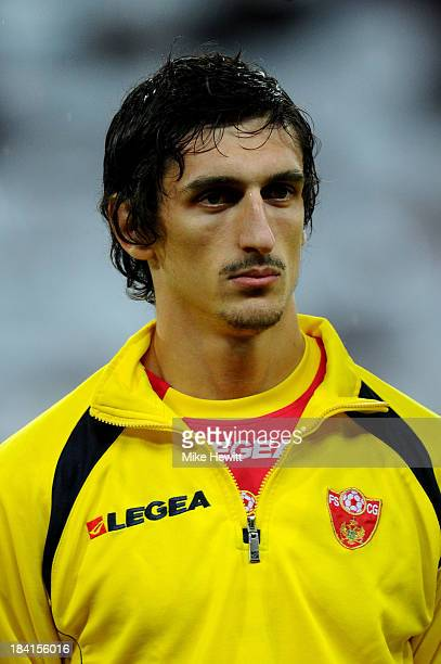 Stefan Savic of Montenegro looks on prior to the FIFA 2014 World Cup Qualifying Group H match between England and Montenegro at Wembley Stadium on...