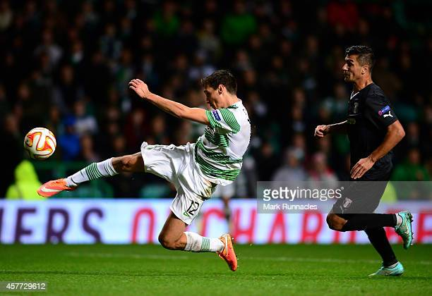Stefan Scepovic of Celtic takes a snap shot on the edge of the penalty box watched by Cristian Oros of FC Astra Giurgiu during the UEFA Europa League...