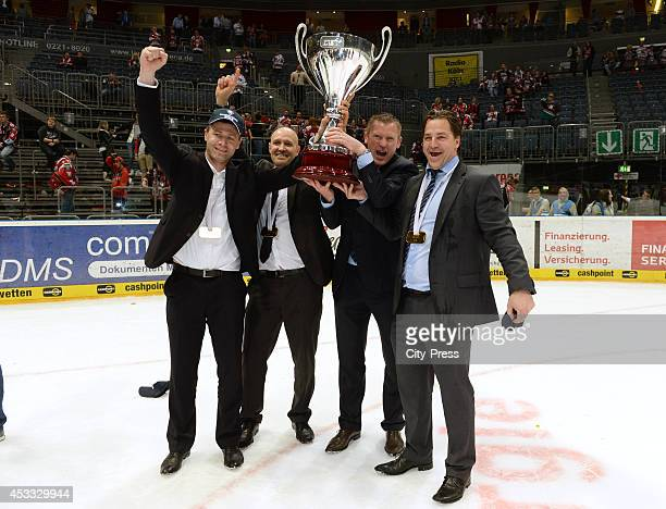 Stefan Schaidnagel , Jonas Forsberg , Niklas Sundblad and Petri Liimatainen hold the trophy after game seven of the DEL playoff final on April 29,...