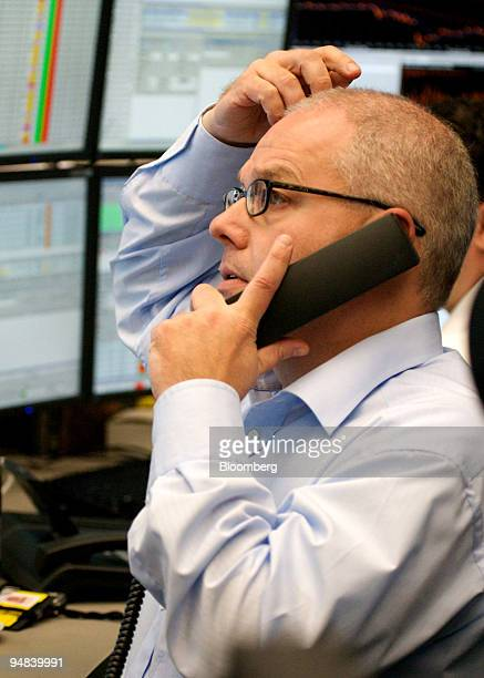 Stefan Scharfetter, a trader, at work on the telephone at the Frankfurt Stock Exchange in Frankfurt, Germany, on Tuesday, Sept. 30, 2008. U.S....