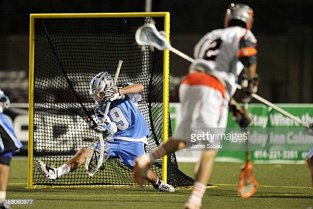 Stefan Schroder of the Ohio Machine is unable to stop a shot as Justin Turri of the Denver Outlaws scores in the second half on May 4 2013 at Selby...