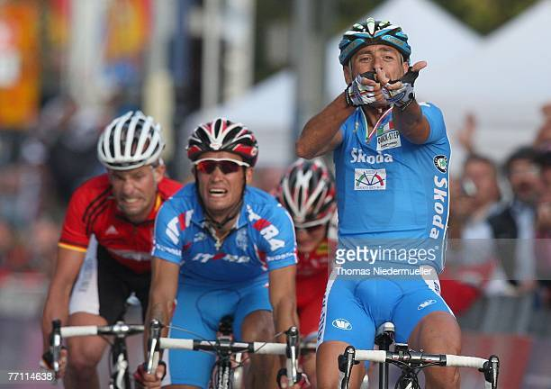 Stefan Schumacher of Germany , Alexandr Kolbonev of the Russian Federation and Paolo Bettini of Italy wins the men's elite race during the UCI Road...