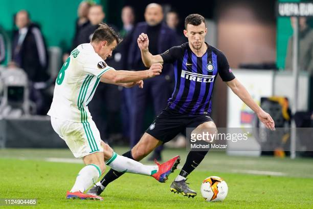 Stefan Schwab of Rapid and Ivan Perisic of FC Internazionale during the UEFA Europa League Round of 32 first leg match between SK Rapid Wien and FC...