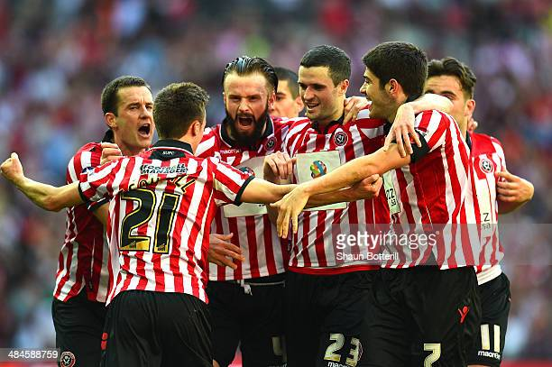 Stefan Scougall of Sheffield United is mobbled by his team mates after scoring their second goal during the FA Cup with Budweiser semifinal match...
