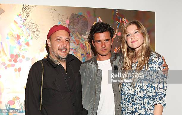 Stefan Simchowitz actor/producer Orlando Bloom and artist Petra Cortright attend the Depart Foundation's public opening and reception of Petra...