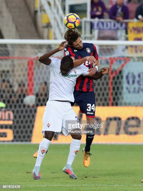 Stefan Simic of Crotone competes for the ball in air with Khouma Babacar of Fiorentina during the Serie A match between FC Crotone and ACF Fiorentina...