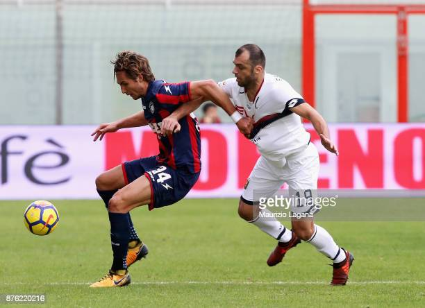 Stefan Simic of Crotone competes for the ball with Goran Pandev of Genoa during the Serie A match between FC Crotone and Genoa CFC at Stadio Comunale...