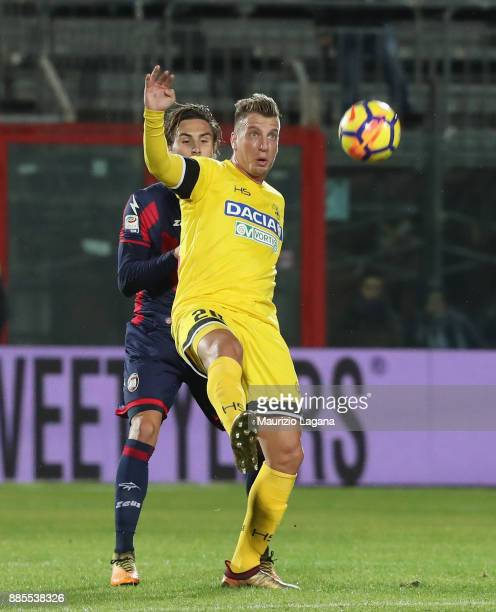 Stefan Simic of Crotone competes for the ball with Maxi Lopez of Udinese during the Serie A match between FC Crotone and Udinese Calcio at Stadio...
