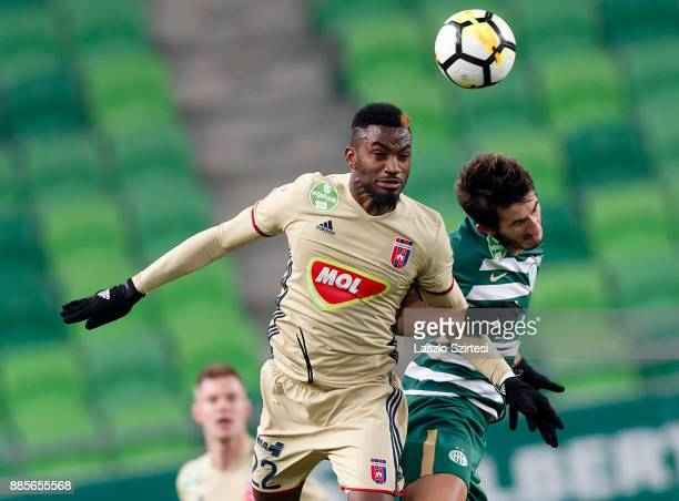 Stefan Spirovski of Ferencvarosi TC battles for the ball in the air with Ianique dos Santos Tavares 'Stopira' #22 of Videoton FC during the Hungarian...