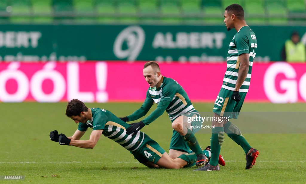 Stefan Spirovski #4 of Ferencvarosi TC celebrates his goal with Gergo Lovrencsics (L2) of Ferencvarosi TC and Kenneth Otigba #22 of Ferencvarosi TC during the Hungarian OTP Bank Liga match between Ferencvarosi TC and Videoton FC at Groupama Arena on December 2, 2017 in Budapest, Hungary.
