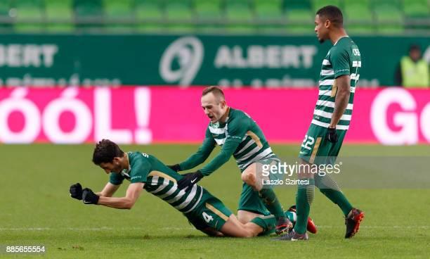 Stefan Spirovski of Ferencvarosi TC celebrates his goal with Gergo Lovrencsics of Ferencvarosi TC and Kenneth Otigba of Ferencvarosi TC during the...