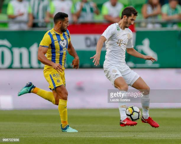 Stefan Spirovski of Ferencvarosi TC controls the ball in front of Eyal Golasa of Maccabi Tel Aviv FC during the UEFA Europa League First Qualifying...