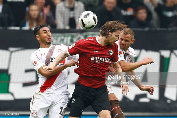 Stefan Strandberg of Hannover challenges Aziz Bouhaddouz and Bernd Nehrig of St Pauli during the Second Bundesliga match between Hannover 96 and FC...