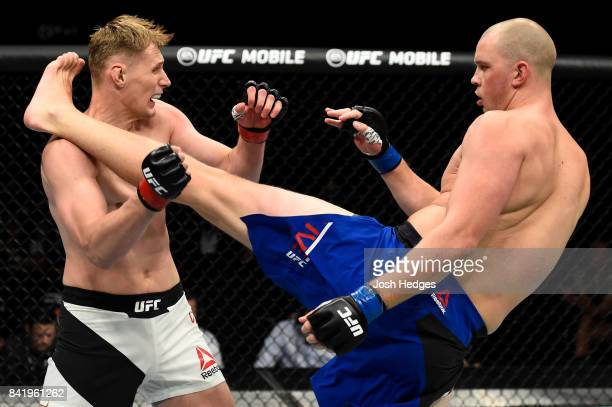 Stefan Struve of The Netherlands kicks Alexander Volkov of Russia in their heavyweight bout during the UFC Fight Night event at the Rotterdam Ahoy on...