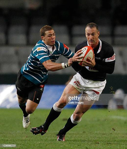 Stefan Terblanche of the Sharks is grabbed by Bjorn Basson during the Absa Currie Cup match between the Sharks and GWK Griquas at Absa Stadium on...