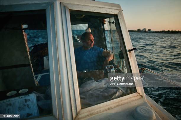 Stefan Toporau the owner of a small local fishing company who uses dolphin friendly fishing nets sails on his boat on September 1 2017 on the Black...