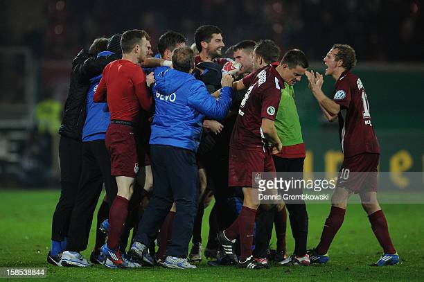 Stefan Vogler of Offenbach celebrates with teammates during the DFB Cup match between Kickers Offenbach and Fortuna Duesseldorf at...