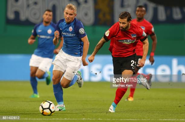 Stefan Wannenwetsch of Rostock battles for the ball with Marvin Plattenhardt of Berlin during the DFB Cup first round match between FC Hansa Rostock...
