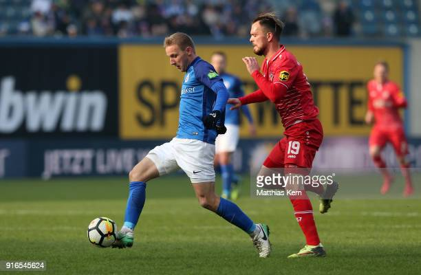 Stefan Wannenwetsch of Rostock battles for the ball with Orhan Ademi of Wuerzburg during the 3 Liga match between FC Hansa Rostock and FC Wuerzburger...