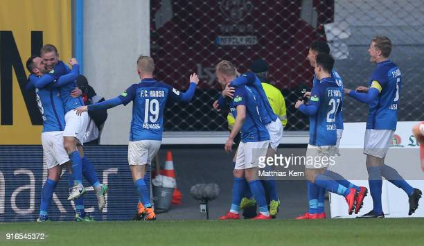 Stefan Wannenwetsch of Rostock jubilates with team mates after scoring the second goal during the 3 Liga match between FC Hansa Rostock and FC...