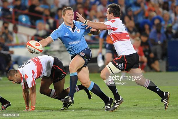 Stefan Watermeyer of the Bulls breaks the tackle of Doppies la Grange of the Lions to go on and score a try during the Absa Currie Cup match between...