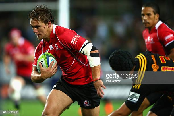 Stefan Watermeyer of the Lions breaks the tackle of Charlie Ngatai of the Chiefs during the round 12 Super Rugby match between the Chiefs and the...