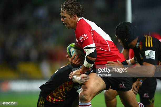 Stefan Watermeyer of the Lions is tackled during the round 12 Super Rugby match between the Chiefs and the Lions at Waikato Stadium on May 3 2014 in...