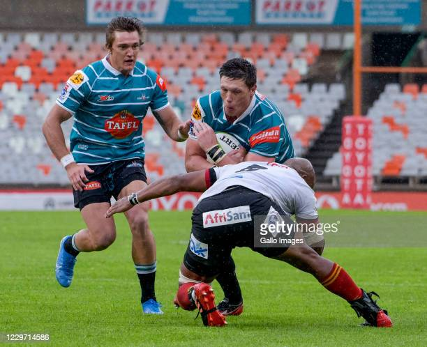 Stefan Willemse with Andre Swarts of Tafel Lager Griquas tackled by Andisa Ntsila of Toyota Cheetahs during the Super Rugby Unlocked match between...
