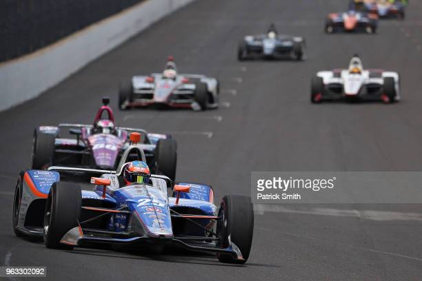 Stefan Wilson driver of the #Driven2SaveLives Honda races during the 102nd Indianapolis 500 at Indianapolis Motorspeedway on May 27 2018 in...
