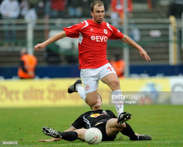 Stefan Zinnow of Offenbach battles for the ball with Jan Fiesser of Sandhausen during the 3 Liga match between Kickers Offenbach and SV Sandhausen at...