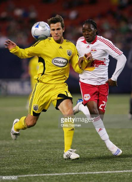 Stefani Miglioranzi of the Columbus Crew and Kevin Goldthwaite of the New York Red Bulls battle for the ball at Giants Stadium in the Meadowlands on...
