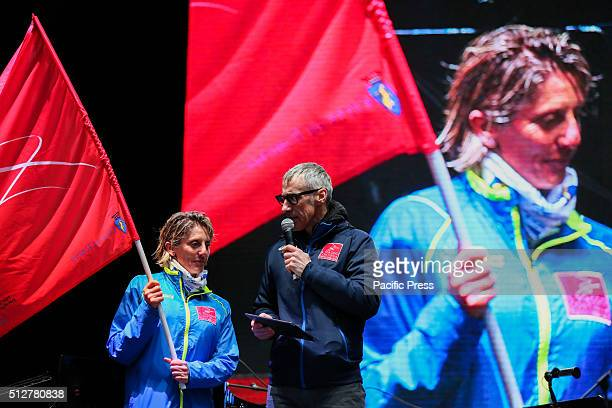 Stefania Belmondo holds an Olympics Flag during the celebration of 10th year anniversary of the XX Turin Winter Olympic Games