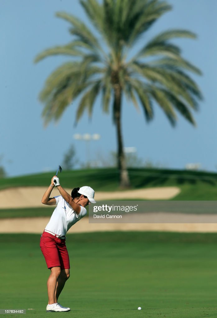 Stefania Croce of Italy plays her second shot at the par 4, first hole during the first round of the 2012 Omega Dubai Ladies Masters on the Majilis Course at the Emirates Golf Club on December 5, 2012 in Dubai, United Arab Emirates.