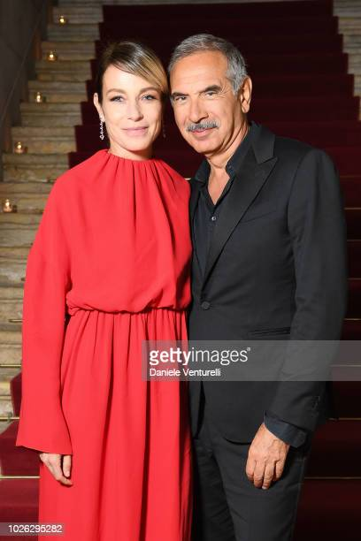 Stefania Rocca and Carlo Capasa attend 2018 Kineo Dinner during the 75th Venice Film Festival on September 2 2018 in Venice Italy