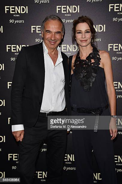 Stefania Rocca and Carlo Capasa attend the Fendi Roma 90 Years Anniversary Welcome Cocktail at Palazzo Carpegna on July 7 2016 in Rome Italy