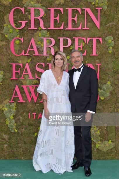 Stefania Rocca and Carlo Capasa attend The Green Carpet Fashion Awards Italia 2018 at Teatro Alla Scala on September 23 2018 in Milan Italy