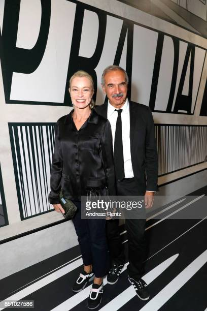 Stefania Rocca and Carlo Capasa attend the Prada show during Milan Fashion Week Spring/Summer 2018 on September 21 2017 in Milan Italy
